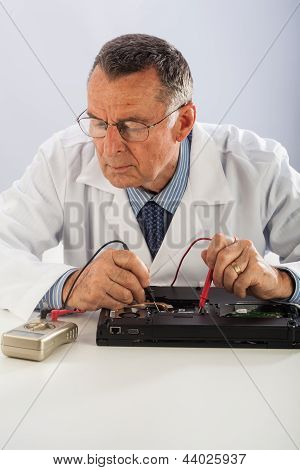 Senior Technician Repairing Laptop