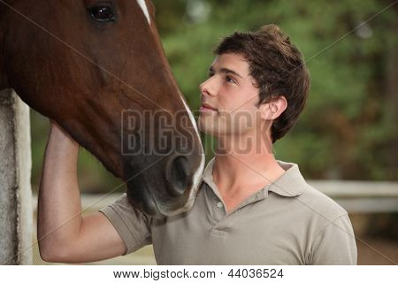 Man stood with horse