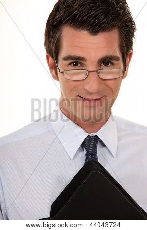 Young businessman wearing glasses and holding folder