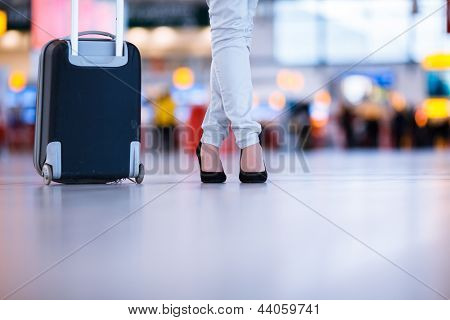 Pretty young female passenger at the airport (shallow DOF; color toned image)