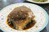 Malay Kueh Lopes with Gula Melaka Sugar Syrup and Grated Coconut Dessert poster