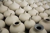 Unfinished porcelain pottery waiting to be fired in a kiln poster