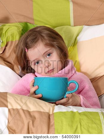 Little girl sitting sick in bed poster