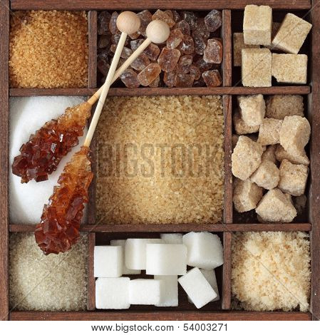 Various kinds of sugar in wooden box poster