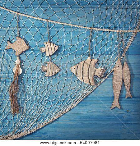 Marine life decoration and on blue shabby background