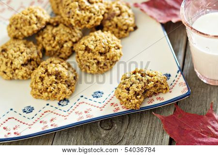 Pumpkin oat cookies on a plate on wooden table