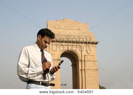 young indian using mobile phone