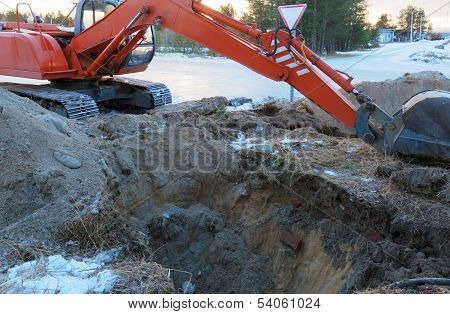 Excavator Tractor Digging A Trench.