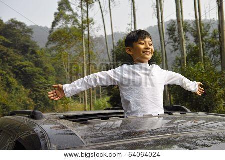 Happy Boy Travel In Car
