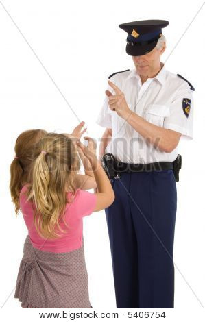 Two Little Girls Are Showing Disrespecfull Behavior Towards A Dutch Police Officer