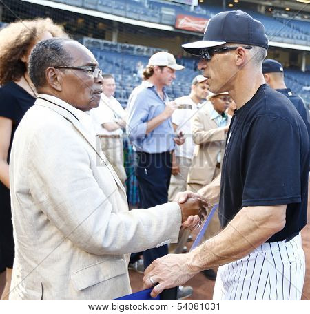 BRONX, NY-JUNE 1; Supercentenarian Bernando LaPallo, who is 111 years old, shakes hands with New York Yankees manager Joe Girardi (R) before a game on June 1, 2013 at Yankee Stadium in the Bronx.