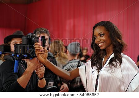 NEW YORK NY - NOVEMBER 13: Model Maria Borges prepares backstage