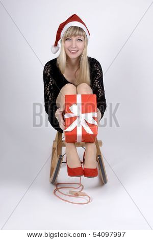 Woman On A Sleigh With Gift