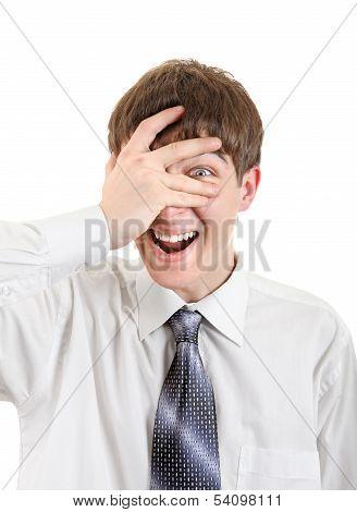 Teenager Peeps Through His Fingers