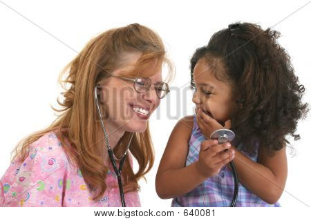 Little Girl And Smiling Nurse