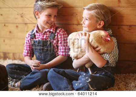 Young Child on a Farm With Animals