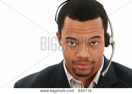 Attractive Business Man With Phone Headset