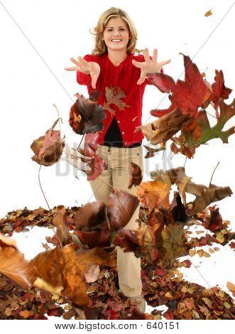 Blond Woman Throwing Leaves