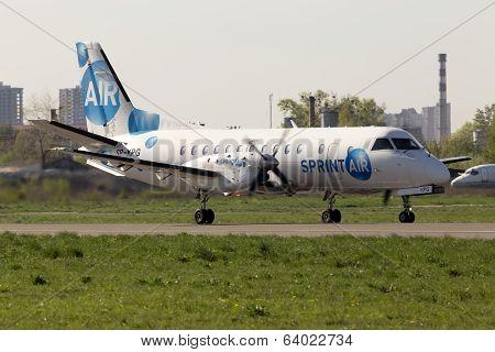 SprintAir Saab 340 aircraft running on the runway