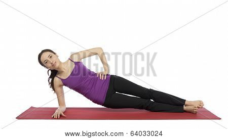 Young Woman Doing A Variation Of Side Plank Pose