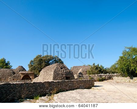 Ancient agricultural outhouses made of dry stones in The Bories Village (Village des bories) near Gordes Provence in France poster
