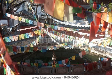 Tibetan Buddhist Prayer Flags In Chinese Temple.