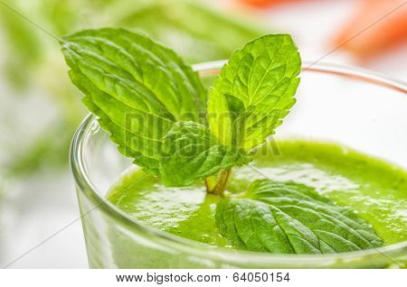 Green smoothie decorated with mint leaves