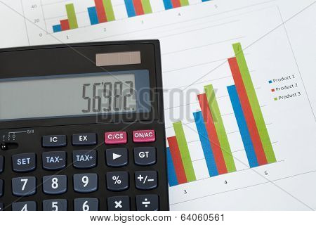 Photo Of Calculator And Growth Charts