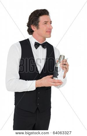 Thoughtful bartender holding cocktail shaker isolated over white background