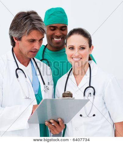 Portrait Of Medical Team Taking Notes