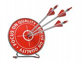 Focus on Quality Concept. Three Arrows Hit in Red Target. poster