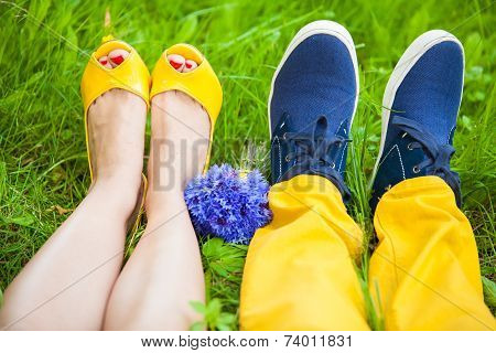 Two Pair Of Legs On Grass