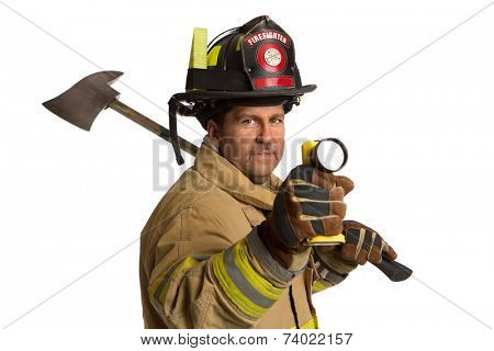 Serious looking confident firefighter standing holding ax and flash light portrait isolated on white background
