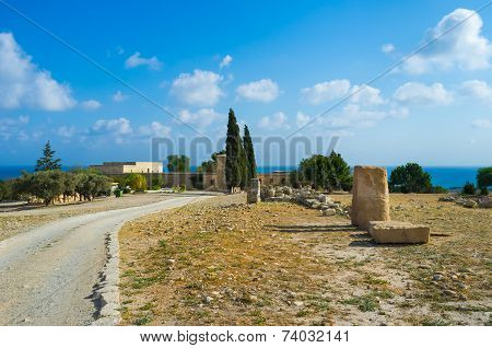 The footpath leads to the museum along the ruins of Aphrodite Sanctuary Kouklia Cyprus. poster