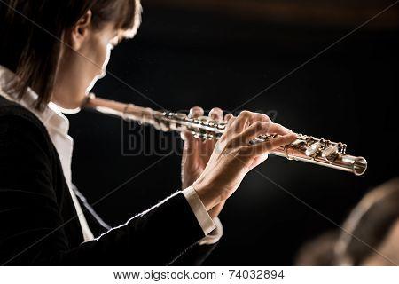 Female Flutist Performing