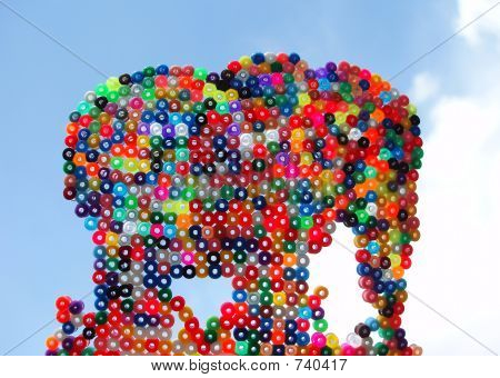 Perspective shot of elephant handmade with plastic pearls poster