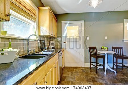 Kitchen Room With Maple Storage Cabinets And Dining Area