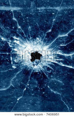 Window bullet hole