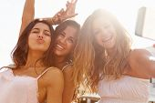 Three Teenage Girls Dancing And Taking Selfie poster