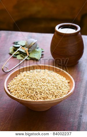 Popped white quinoa (lat. Chenopodium quinoa) cereal in bowl with coca leaves and tea in the back photographed with natural light (Selective Focus Focus one third into the quinoa cereal) poster