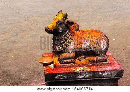Statue of Lord Nandeshwara ~ Vehicle of Lord Shiva showered with vermilion and turmeric holy powders poster