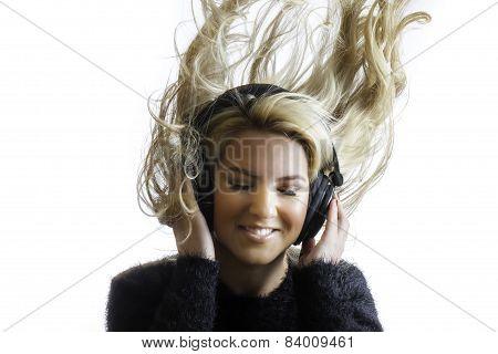 Pretty Girl Flinging Hair Listening Headphones Isolated Background