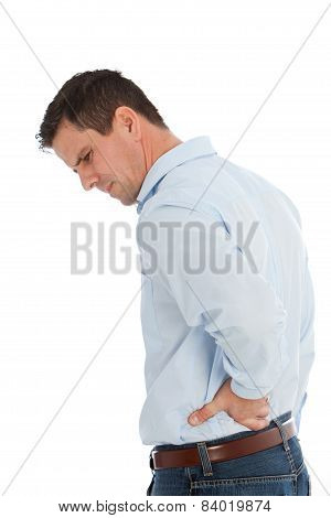 Man Holding His Back With Back Pain