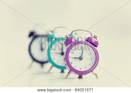 Three Alarm Clocks On White Background.