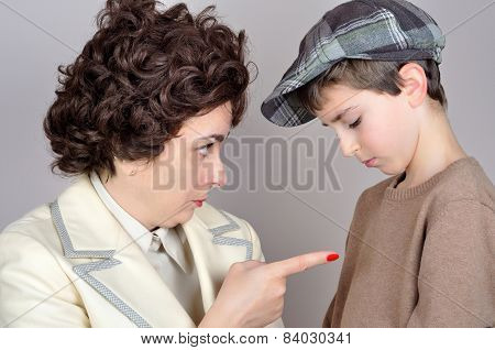 Woman scolding a young boy