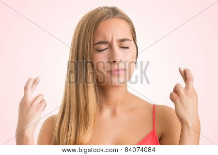 Woman crossing her fingers for good luck poster
