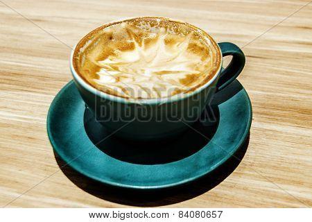 Capuccino Coffee On Wood Table
