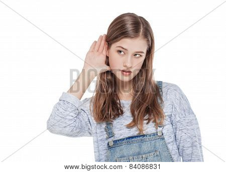 Young Teenage Fashion Girl Holds His Hand Near His Ear And Listening