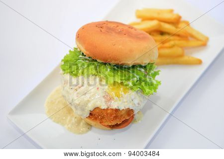Dory burger with potato chips on white plate