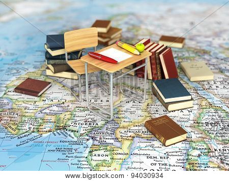 Chair And Desk With Book On The World Map. World Learn Concept.